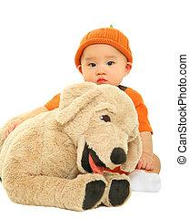 Baby Hugging Stuffed Animal