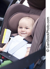 Baby in a car in a child seat