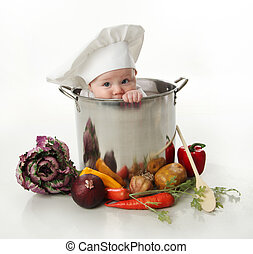 Baby in a cooking pot - Portrait of a smiling baby sitting ...