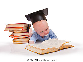 Baby in a hat of the bachelor and the book. Concept of early education