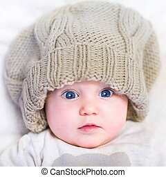 Baby in a knitted hat