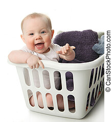 Baby in a laundry basket - Portrait of an adorable baby ...
