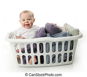Baby in a laundry basket