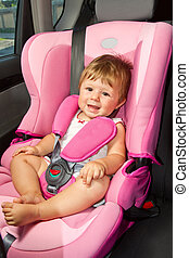 baby in a safety car seat.