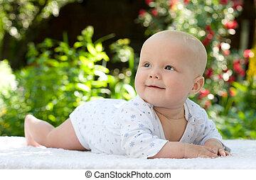 Baby in a summer garden