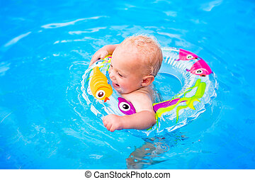 Baby in a swimming pool - Adorable little baby boy having...