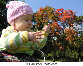 baby in autumn. sun