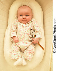 Baby in Bassinet - Baby in bassinet with stuffed toy....