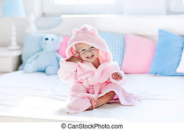 Baby in bathrobe or towel after bath - Cute happy laughing ...