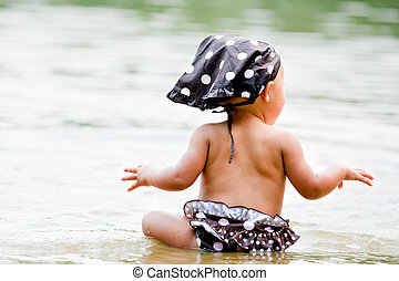 Baby in bikini in the water