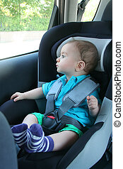 Baby in car seat for safety,