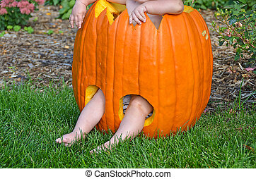 baby in carved pumpkin