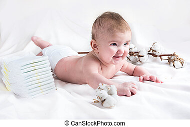 Baby in diaper on a white backgroun