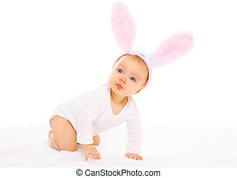 Baby in easter bunny ears on a white background
