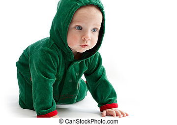 Baby in elf-costume on a white background
