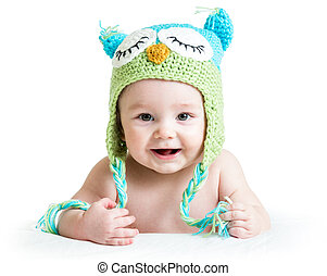 baby in funny owl knitted hat owl on white background