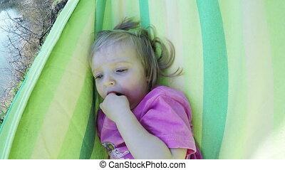 Baby in hammock - Little girl swing in a hammock by river