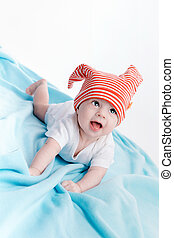 Baby in hat lying