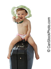 Baby in hat on a valise