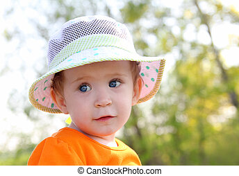 baby in hat outdoor