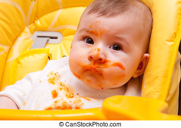Baby in high chair covered in food