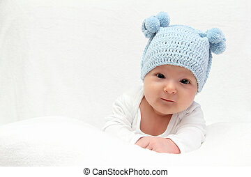 42cc2da79 Baby girl in knitted monkey hat. Attractive 6 month old baby girl in ...