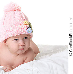 Baby in knitted hat isolated on white
