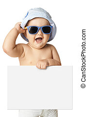 baby in panama and sunglasses holding a banner