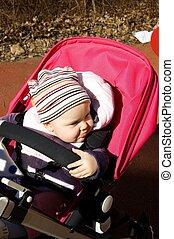Baby in pram - Photo of 11 months old baby sitting in pram