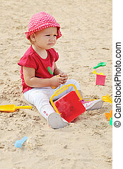 baby in sand