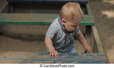 Baby in sandbox