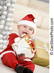 Baby In Santa Costume At Christmas