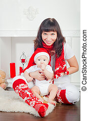 Baby in Santa's Hat And His Mother