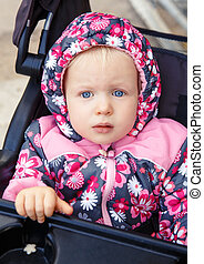 Baby in stroller outside