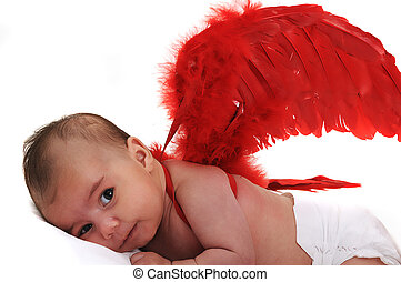 baby in studio smiling and wearing red angle wings