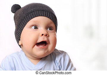 Baby in the hat smiling
