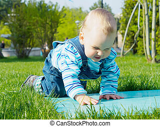Baby in the park - Portrait of nice caucasian baby boy ...