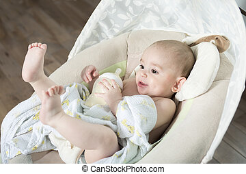 Baby inside the house having good time