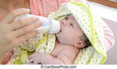 drinking from his bottle - Baby is drinking from his bottle,...