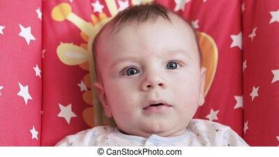 Baby is happy in the cradle