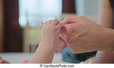 Baby is Holding Mother's Finger
