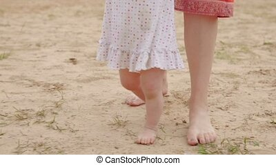 Baby is making the first steps - First baby's steps on the...