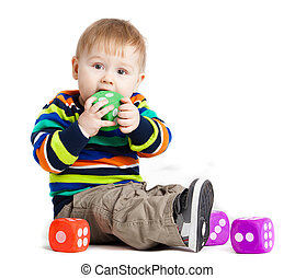 baby is playing with  toys over white background. Funny little kid playing with cup toys
