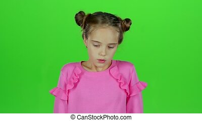 Baby is sad in an empty room. Green screen. Slow motion -...