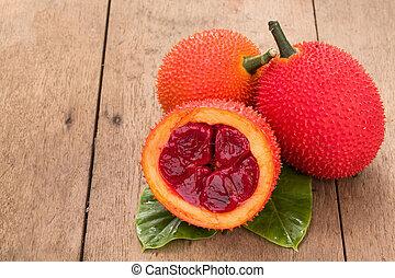 Baby Jackfruit on wooden background - Gac fruit, Baby...