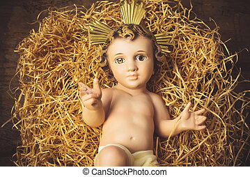 Baby Jesus in his crib.