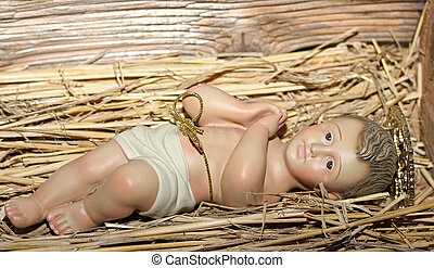 Baby Jesus is laid in the cradle in a manger