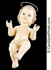 Baby Jesus - antique figure of baby jesus isolated on black...