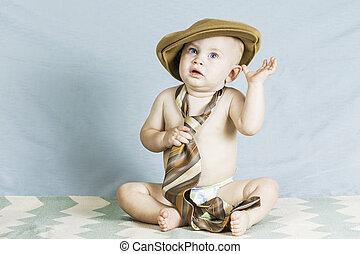 baby jongen, hoedje, vastknopen