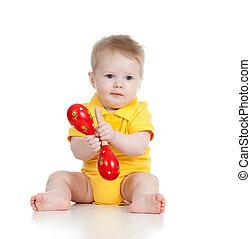 baby jongen, spelend, met, muzikalisch, toys., vrijstaand, op wit, backgroun